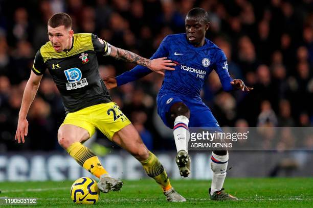 Southampton's Danish midfielder PierreEmile Hojbjerg vies with Chelsea's French midfielder N'Golo Kante during the English Premier League football...