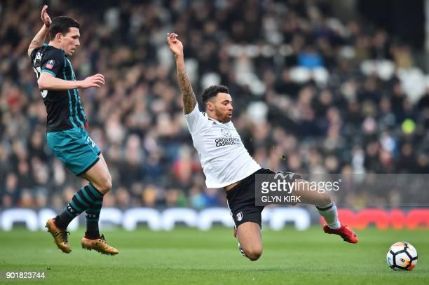 Southampton's Danish midfielder PierreEmile Hojbjerg vies with Fulham's English defender Ryan Fredericks during the English Premier League football...
