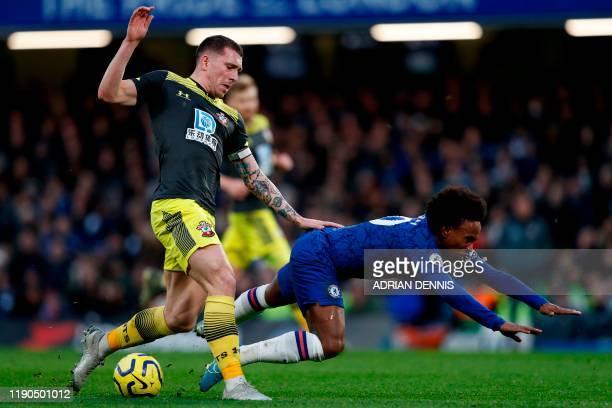 Southampton's Danish midfielder PierreEmile Hojbjerg vies with Chelsea's Brazilian midfielder Willian during the English Premier League football...