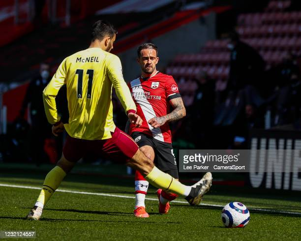 Southampton's Danny Ings passes the ball despite the attentions of Burnley's Dwight McNeil during the Premier League match between Southampton and...