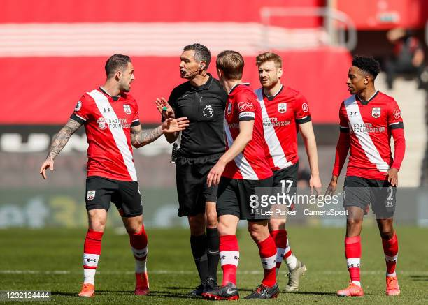 Southampton's Danny Ings questions Referee Andre Marriner after he gives a penalty after consulting VAR with James Ward-Prowse, Stuart Armstrong and...