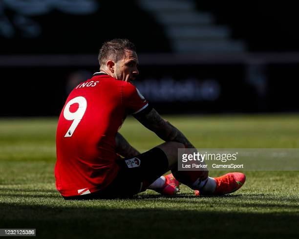 Southampton's Danny Ings sits on the floor after having a header cleared off the line during the Premier League match between Southampton and Burnley...