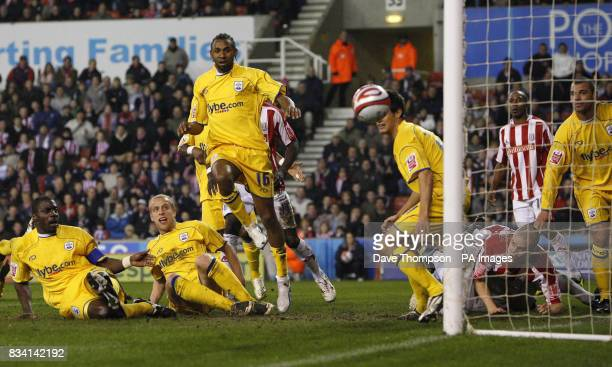Southampton's Darren Powell, left, scores an own goal during the Coca-Cola Championship match at the Britannia Stadium, Stoke.