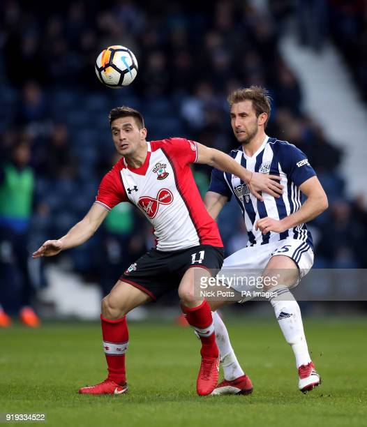 Southampton's Dusan Tadic and West Bromwich Albion's Craig Dawson battle for the ball during the Emirates FA Cup Fifth Round match at The Hawthorns...