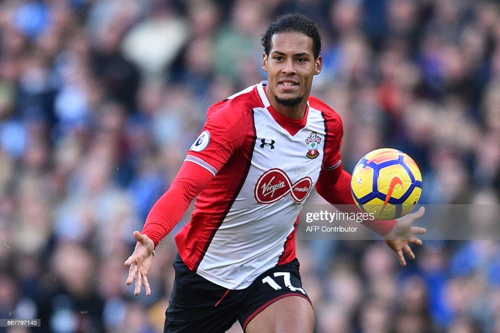 Southampton's Dutch defender Virgil van Dijk chases the ball during the English Premier League football match between Brighton and Hove Albion and Southampton at the American Express Community Stadium in Brighton, southern England on October 29, 2017. / AFP PHOTO / Glyn KIRK / RESTRICTED TO EDITORIAL USE. No use with unauthorized audio, video, data, fixture lists, club/league logos or 'live' services. Online in-match use limited to 75 images, no video emulation. No use in betting, games or single club/league/player publications. /
