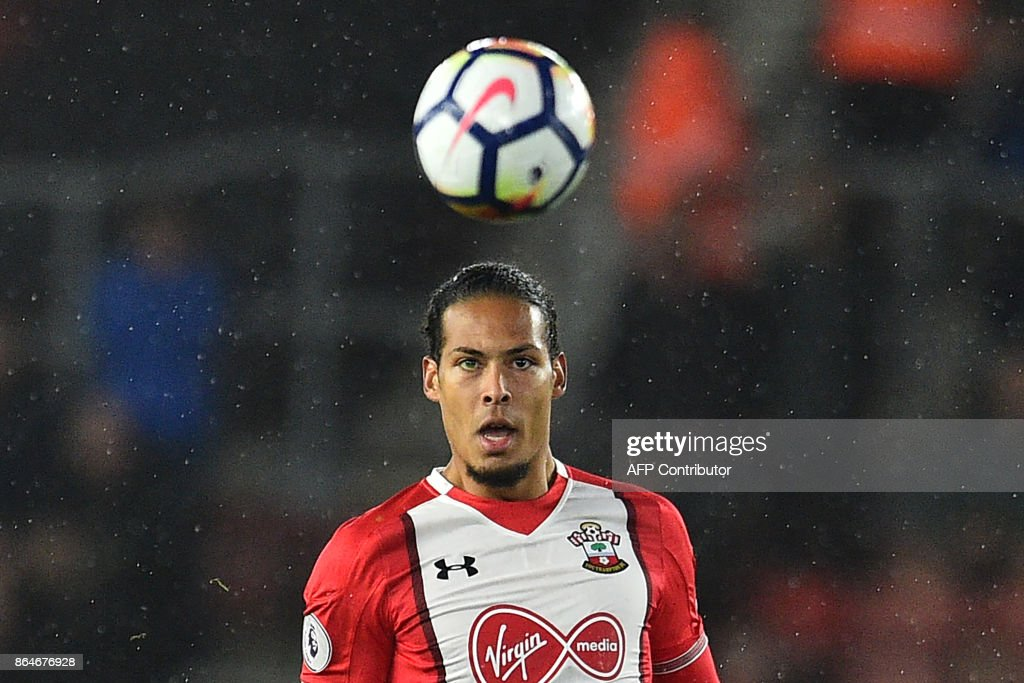 Southampton's Dutch defender Virgil van Dijk watches the ball during the English Premier League football match between Southampton and West Bromwich Albion at St Mary's Stadium in Southampton, southern England on October 21, 2017. / AFP PHOTO / Glyn KIRK / RESTRICTED TO EDITORIAL USE. No use with unauthorized audio, video, data, fixture lists, club/league logos or 'live' services. Online in-match use limited to 75 images, no video emulation. No use in betting, games or single club/league/player publications. /