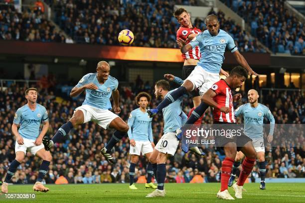 TOPSHOT Southampton's Dutch defender Wesley Hoedt jumps for the ball with Manchester City's Brazilian midfielder Fernandinho during the English...