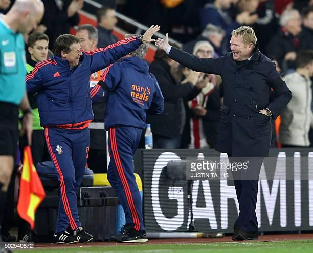 Southampton's Dutch manager Ronald Koeman reacts with coach Erwin Koeman to his team scoring their fourth goal during the English Premier League...