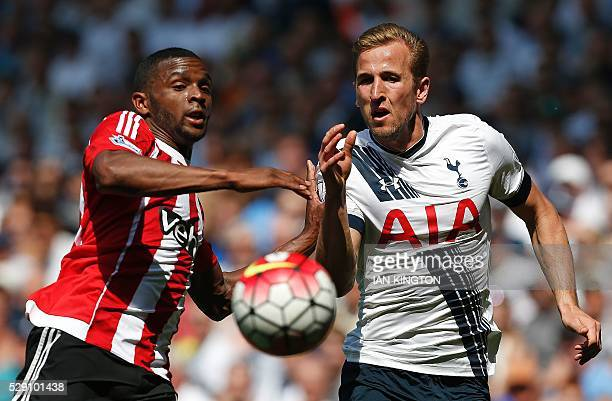 Southampton's Dutchborn Curacao midfielder Cuco Martina and Tottenham Hotspur's English striker Harry Kane chase the ball during the English Premier...