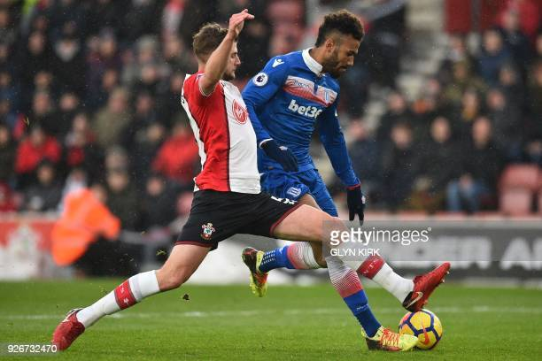 Southampton's English defender Jack Stephens closes in on Stoke City's German midfielder Eric Maxim ChoupoMoting as he prepares to shoot during the...