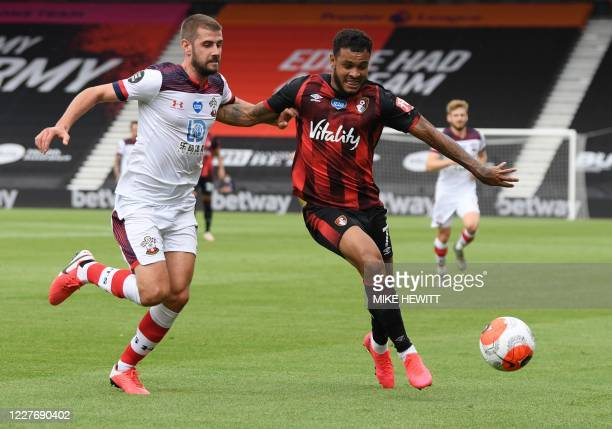 Southampton's English defender Jack Stephens fights for the ball with Bournemouth's Norwegian striker Joshua King during the English Premier League...