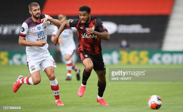 Southampton's English defender Jack Stephens runs for the ball with Bournemouth's Norwegian striker Joshua King during the English Premier League...