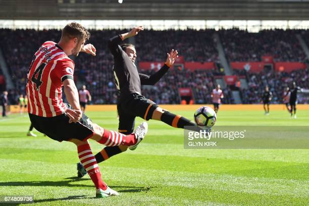 Southampton's English defender Jack Stephens vies with Hull City's Serbian midfielder Lazar Markovi during the English Premier League football match...