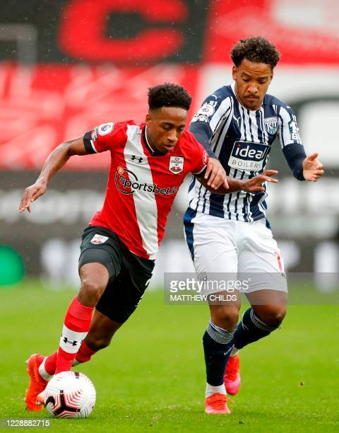 Southampton's English defender Kyle Walker-Peters runs with the ball alongside West Bromwich Albion's Brazilian midfielder Matheus Pereira during the...