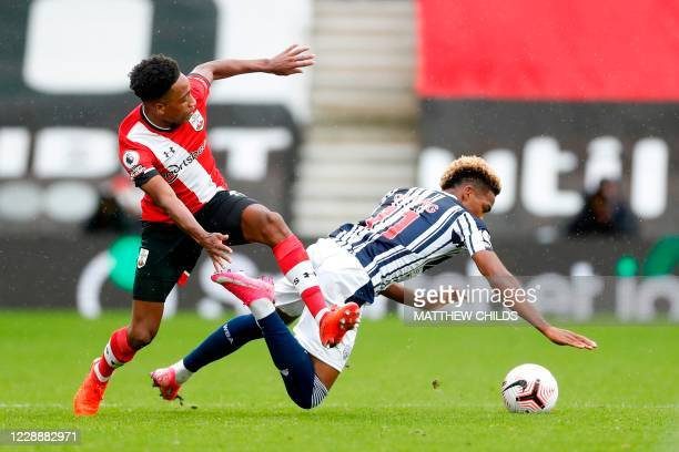 Southampton's English defender Kyle Walker-Peters tackles West Bromwich Albion's DR Congo-born English midfielder Grady Diangana during the English...