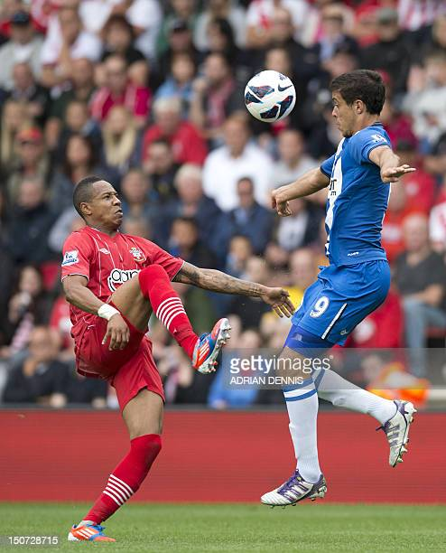 Southampton's English defender Nathaniel Cline vies with Wigan's Argentinian striker Franco Di Santo during the English Premier League football match...