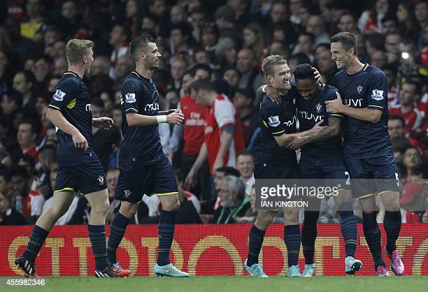 Southampton's English defender Nathaniel Clyne celebrates scoring their second goal with teammates during the English League Cup third round football...