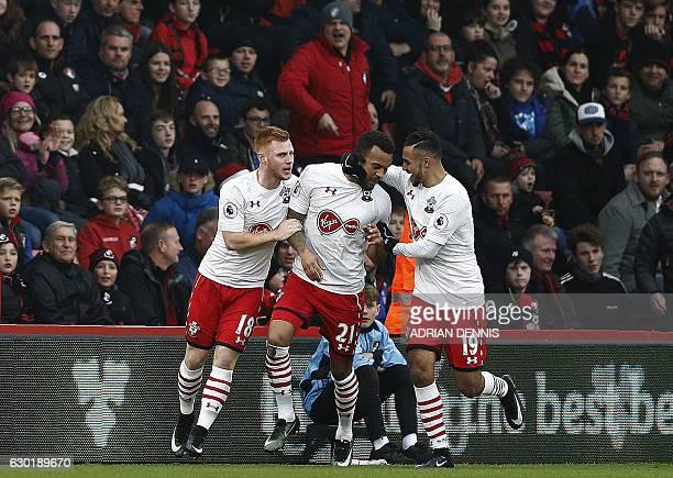 Southampton's English defender Ryan Bertrand celebrates scoring his team's first goal with Southampton's Serbian midfielder Dusan Tadic and...