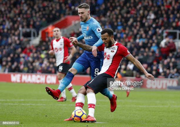 Southampton's English defender Ryan Bertrand clears the ball from Arsenal's Welsh midfielder Aaron Ramsey during the English Premier League football...