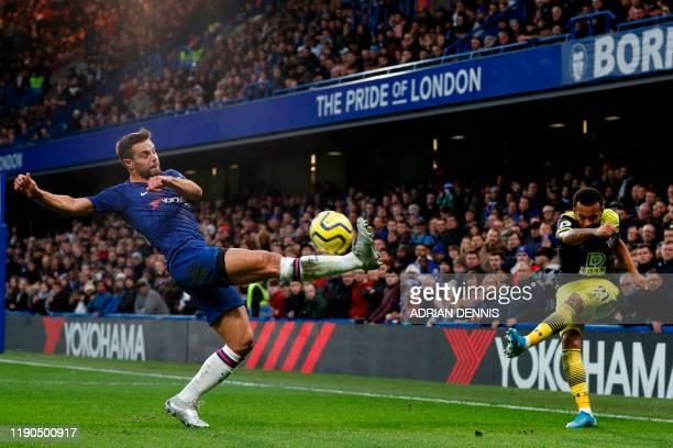 Southampton's English defender Ryan Bertrand crosses the ball as Chelsea's Spanish defender Cesar Azpilicueta tries to block during the English...