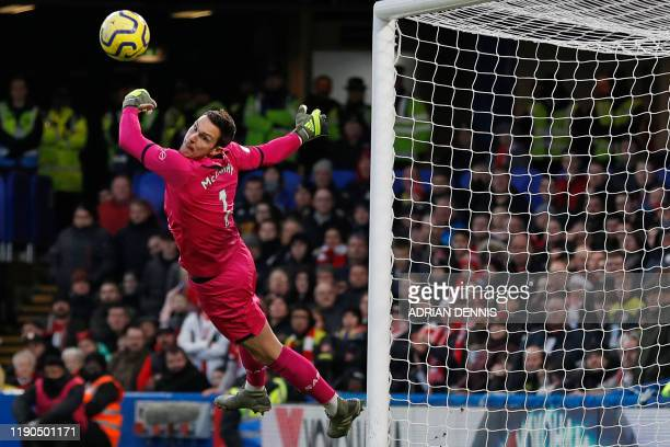 Southampton's English goalkeeper Alex McCarthy makes a save during the English Premier League football match between Chelsea and Southampton at...