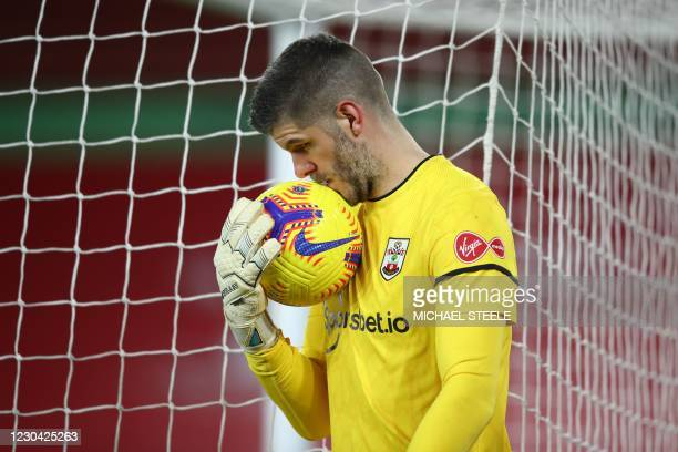 Southampton's English goalkeeper Fraser Forster kisses the ball during the English Premier League football match between Southampton and Liverpool at...