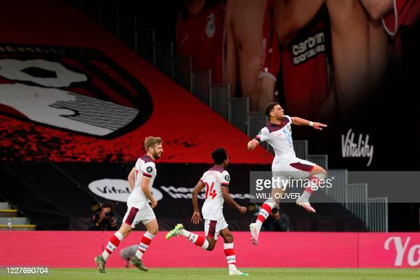 Southampton's English midfielder Che Adams celebrates scoring his team's second goal during the English Premier League football match between...