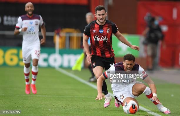 Southampton's English midfielder Che Adams fights for the ball with Bournemouth's English midfielder Lewis Cook during the English Premier League...