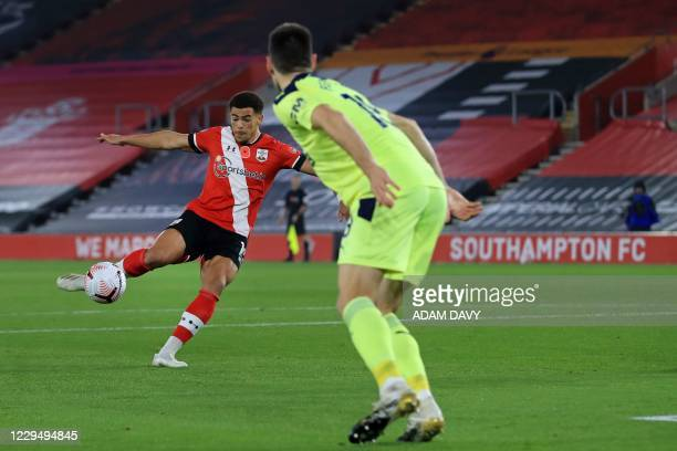 Southampton's English midfielder Che Adams shoots to score the opening goal during the English Premier League football match between Southampton and...