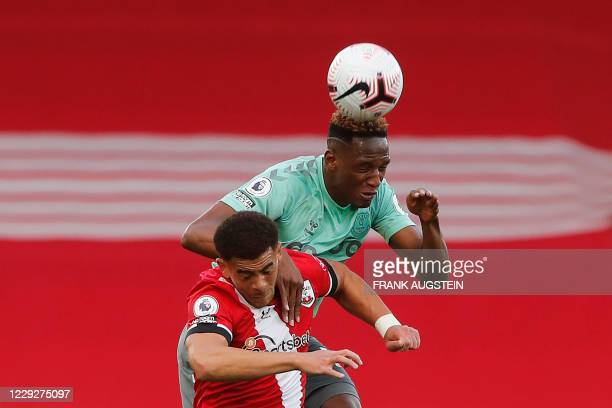 Southampton's English midfielder Che Adams vies for the ball with Everton's Colombian defender Yerry Mina during the English Premier League football...