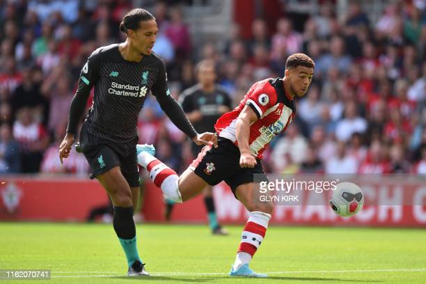 Southampton's English midfielder Che Adams vies with Liverpool's Dutch defender Virgil van Dijk during the English Premier League football match...