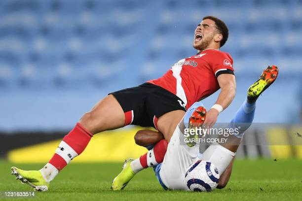 Southampton's English midfielder Che Adams vies with Manchester City's Brazilian midfielder Fernandinho during the English Premier League football...