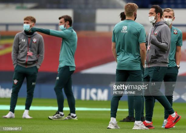 Southampton's English midfielder James WardProwse and Southampton's English striker Danny Ings wearing a face mask or covering due to the COVID19...