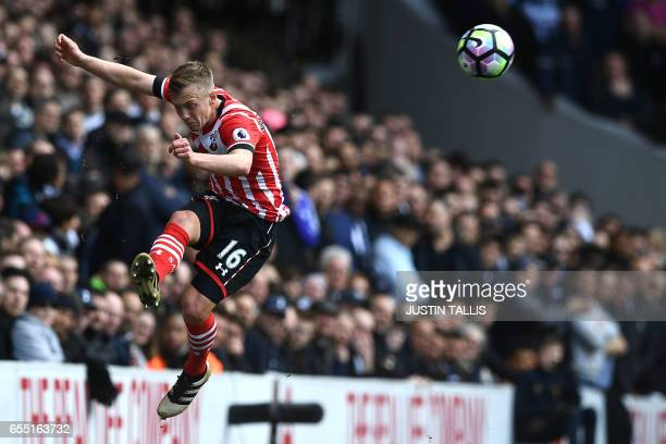 TOPSHOT Southampton's English midfielder James WardProwse kicks the ball during the English Premier League football match between Tottenham Hotspur...