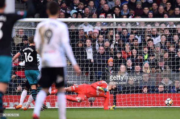 Southampton's English midfielder James WardProwse scores the team's first goal during the English FA Cup third round football match between Fulham...