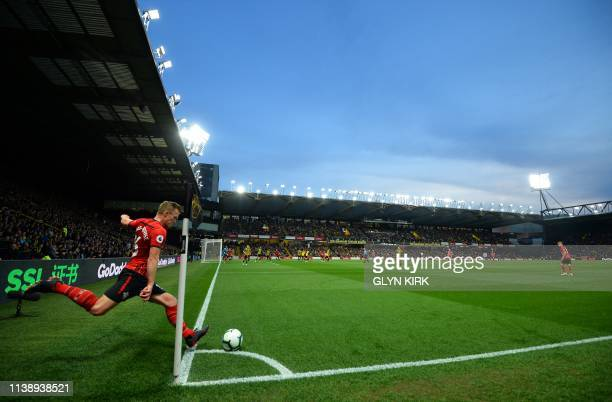 Southampton's English midfielder James WardProwse takes a corner kick during the English Premier League football match between Watford and...