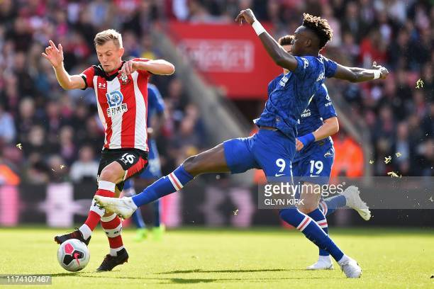 Southampton's English midfielder James WardProwse vies with Chelsea's English striker Tammy Abraham during the English Premier League football match...