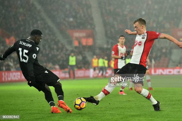 Southampton's English midfielder James WardProwse vies with Crystal Palace's German midfielder Jeffrey Schlupp during the English Premier League...