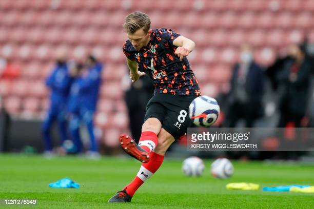 Southampton's English midfielder James Ward-Prowse warms up ahead of the English Premier League football match between Southampton and Chelsea at St...