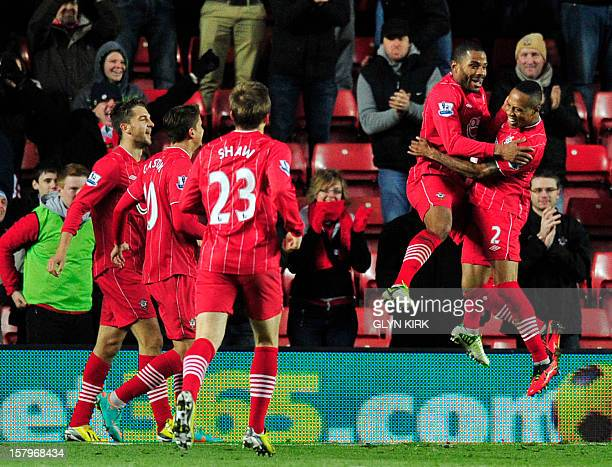 Southampton's English midfielder Jason Puncheon celebrates scoring the opening goal with teammate English defender Nathaniel Clyne during the English...
