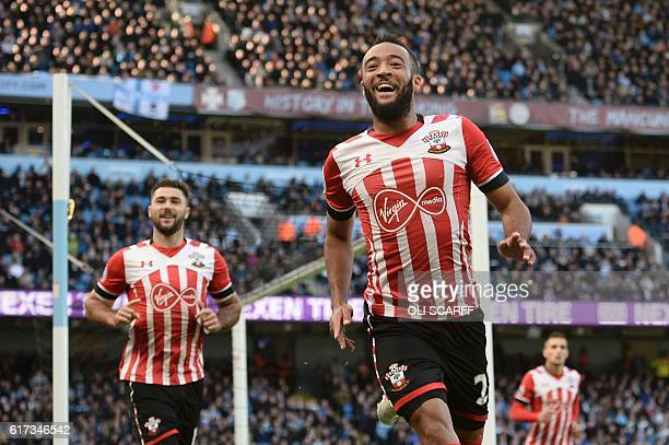 Southampton's English midfielder Nathan Redmond celebrates after scoring the opening goal of the English Premier League football match between...