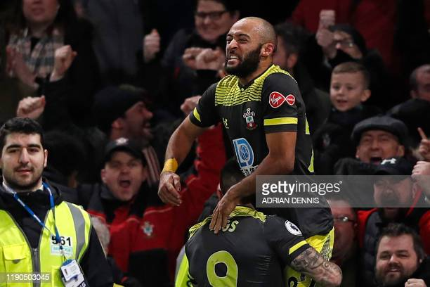 Southampton's English midfielder Nathan Redmond celebrates with Southampton's English striker Danny Ings after scoring their second goal during the...