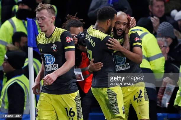 Southampton's English midfielder Nathan Redmond celebrates with Southampton's English midfielder Nathan Redmond after scoring their second goal...