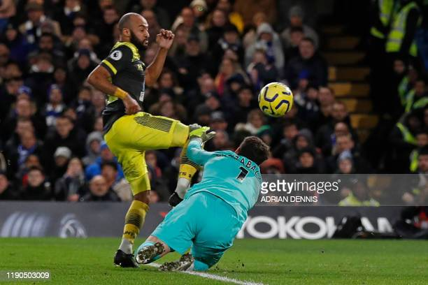 Southampton's English midfielder Nathan Redmond chips the ball over Chelsea's Spanish goalkeeper Kepa Arrizabalaga for their second goal during the...