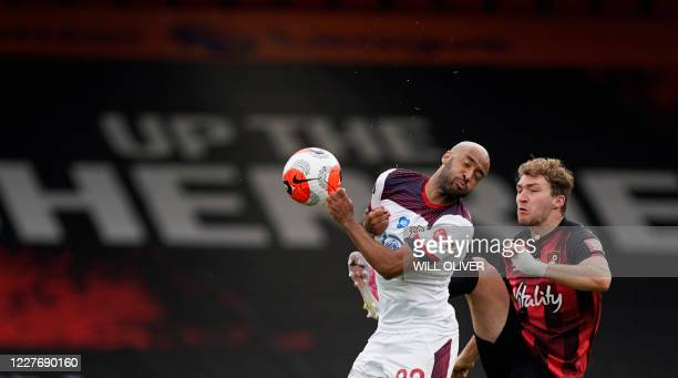 Southampton's English midfielder Nathan Redmond fights for the ball with Bournemouth's English defender Jack Stacey during the English Premier League...