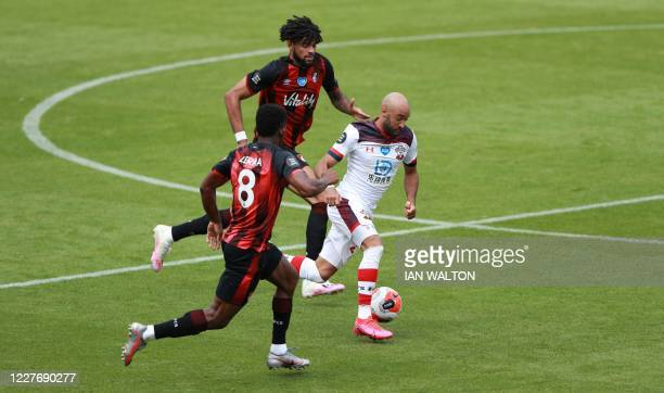 Southampton's English midfielder Nathan Redmond fights for the ball with Bournemouth's Danish midfielder Philip Billing and Bournemouth's Colombian...
