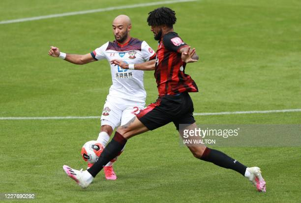Southampton's English midfielder Nathan Redmond fights for the ball with Bournemouth's Danish midfielder Philip Billing during the English Premier...