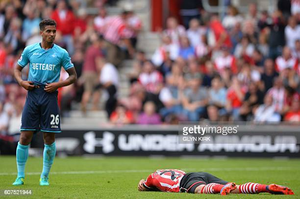 Southampton's English midfielder Nathan Redmond lies on the ground after missing a shot on goal during the English Premier League football match...