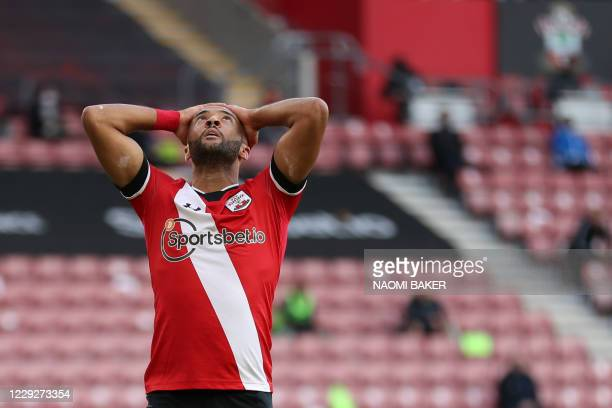 Southampton's English midfielder Nathan Redmond reacts after missing a goal opportunity during the English Premier League football match between...