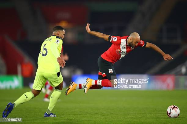 Southampton's English midfielder Nathan Redmond skips over a challenge from Newcastle United's English defender Jamaal Lascelles during the English...